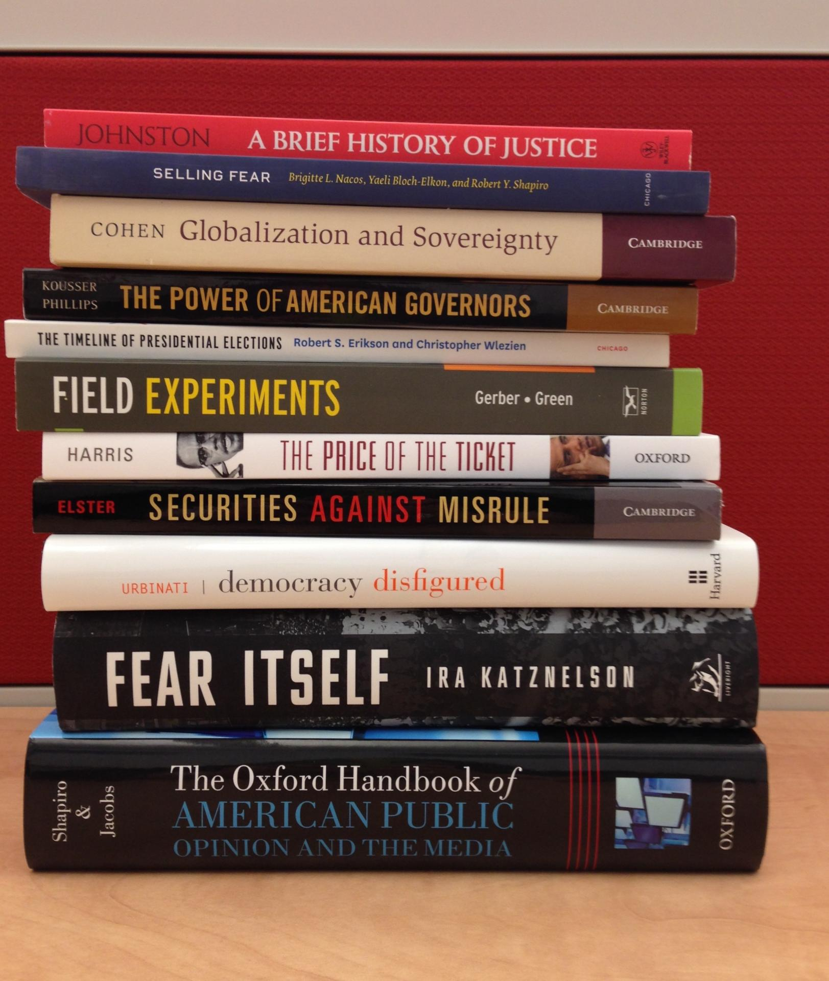 Faculty books on a shelf